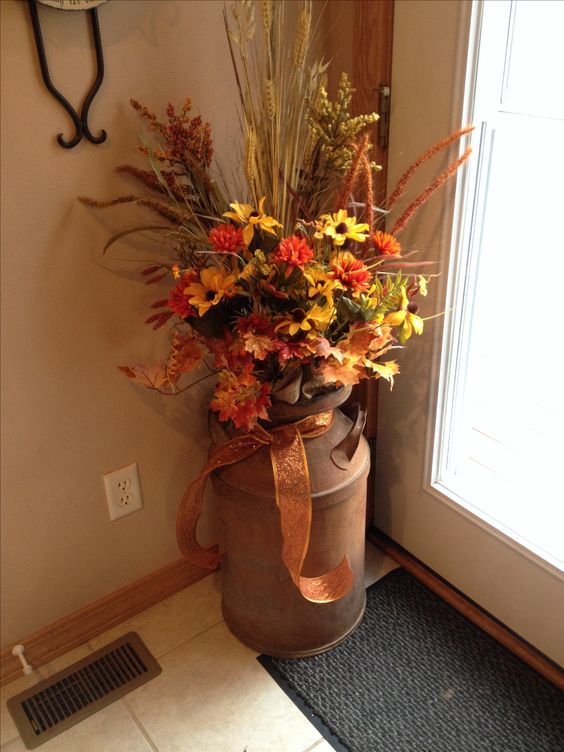 Fall decor - old milk can Fall flowers!