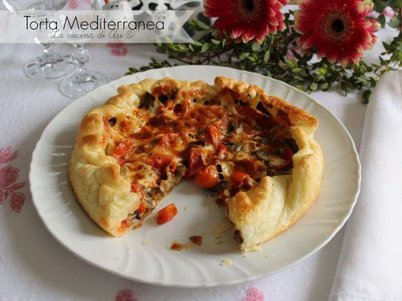 Una torta salata mediterranea buonissima con Asiago,melanzane pomodori ed origano,davvero buonissima da provare assolutamente