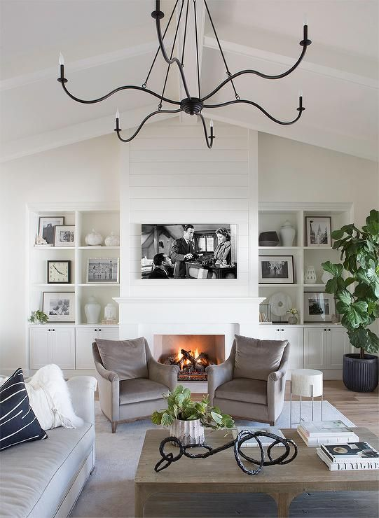 Modern Farmhouse Living Room With A Shiplap Fireplace And Tv Niche