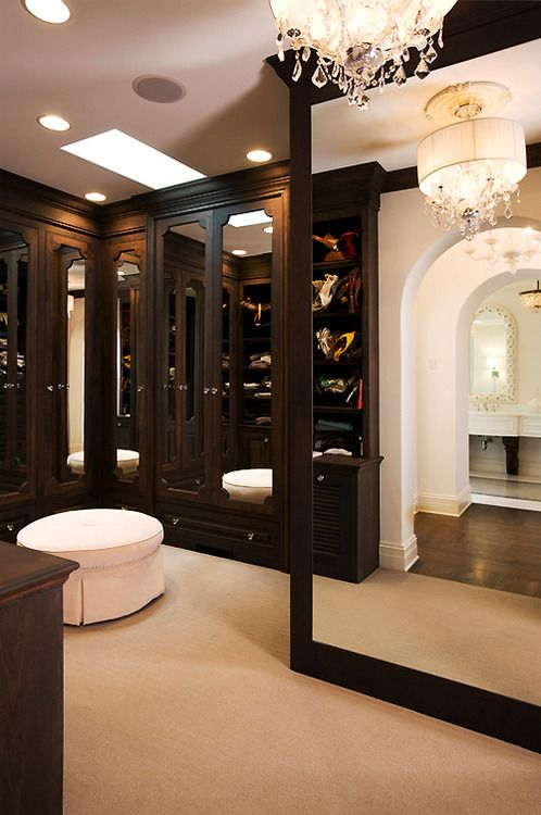 rich wooden tones for a walk-in closet with huge mirror #mirror #closet #storage #organization #allenrothCloset #allenAndRothCloset #closetShelves