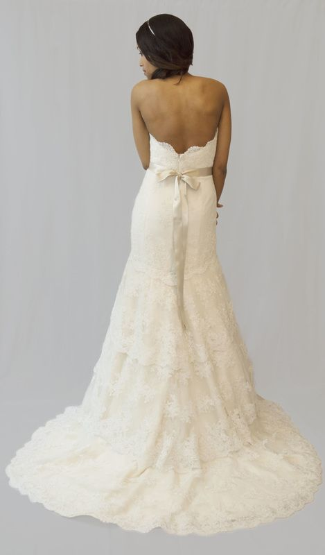 2206 by Tara Keely, size 14. RRP: £1900, now £950 - Ivory Alencon lace with appliquéd belt. Available to try on at Betty Gets Hitched.