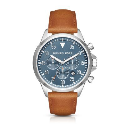 Gage Stainless-Steel and Brown Leather Chronograph Watch Go off the grid with the Michael Kors Gage watch, a handsome timepiece featuring aviation-inspired details. The slate blue chronograph dial showcases a three-hand display and sub dials with distinctive white and red accents give it a modern edge.