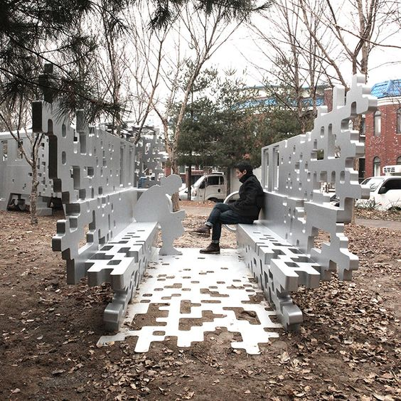 located in suin line memorial park, yong ju lee has designed 'dispersion' for restoring part of a narrow-gauge train at one end and melting the installation into its surroundings at the other