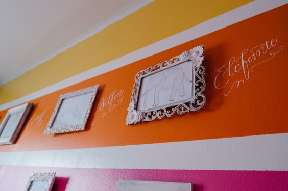 Use your nursery walls as a place for the child to learn. Plus, we love the beautiful calligraphy!