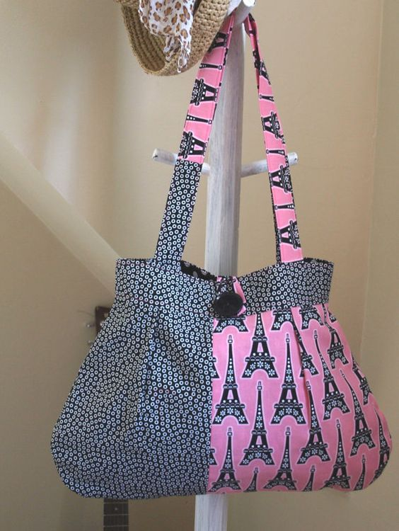 A roomy pleated purse featuring a pink and black Eiffel Tower theme. $30.00 WANT IT WANT IT WANT IT x100,000,000!!!