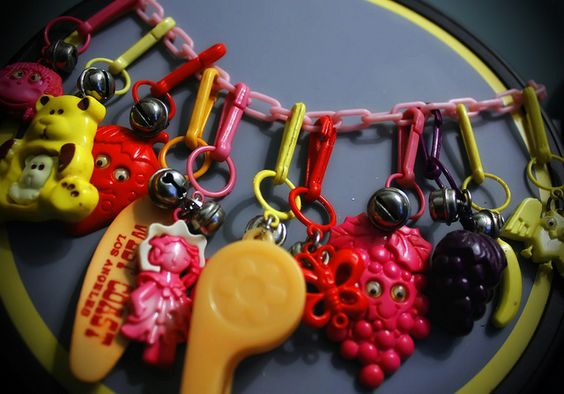 I wish they still had these, so much fun.  my girls would LOVE.    Charm bracelets from the 80's...I had these!