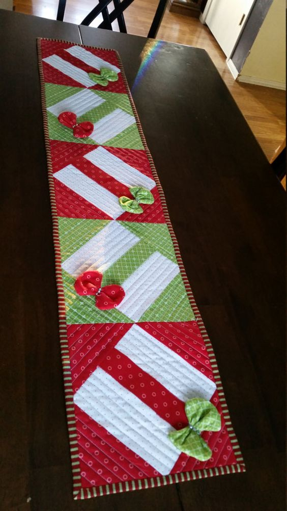 This is a cute quilted table runner, 45x12. The bows actually sparkle under lights as they have rhinestones.  This makes a great wedding gift:
