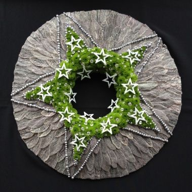 This wreath won the first place in Winter Moments with flowers in Brugge 2013. Organized by Fleur Creatief.