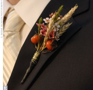 Rustic Boutonnieres...Rosehip berries, wheat and wax flowers tied with metal wire kept the boutonnieres rustic and simple.