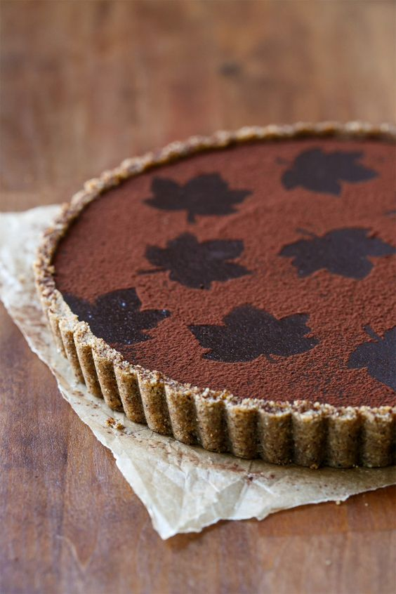 Want something a bit different this Thanksgiving? Try this recipe for a Bittersweet Chocolate Pumpkin Tart with Spiced Pecan Crust