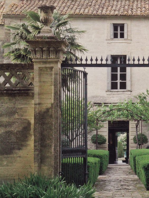 Garden gate ideas and inspiration: a magnificent stone farmhouse or chateau with iron gate entrance. #frenchcountry #garden #courtyard #gate #Provence #formalgarden