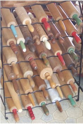 rolling pin collection stored on an old wine rack