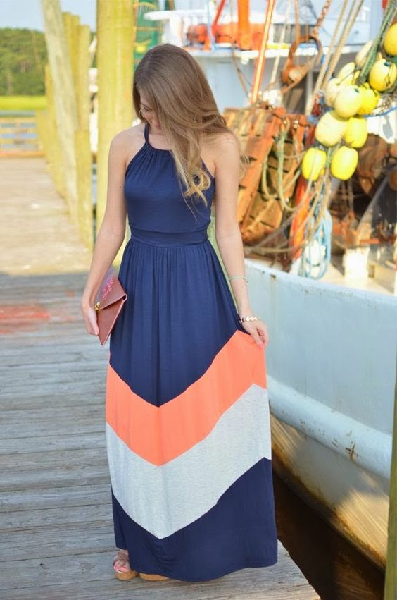 Dark blue maxi dress with orange and white lines Visit blog for more fashion styles and deals