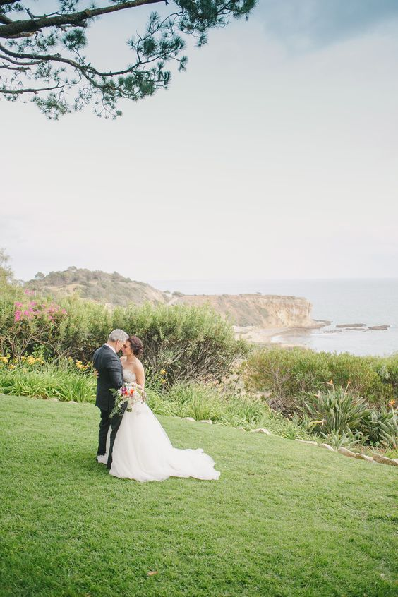 Wedding photo overlooking the ocean at Wayfarer's Chapel in Palos Verdes, CA.   #wayfarerschapel #californiawedding