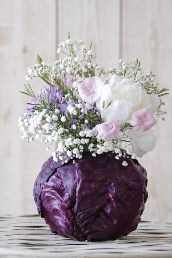 Such a neat idea for a natural vase. #flowers #vegetables # ...