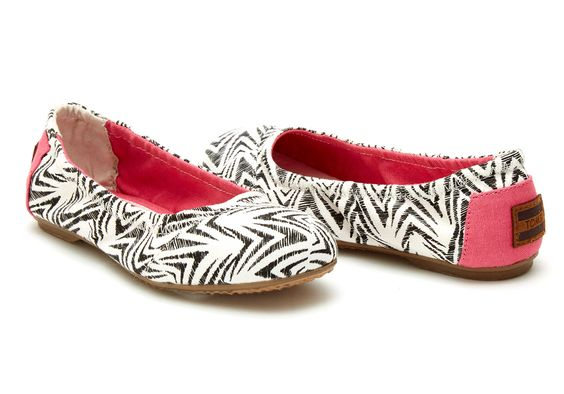 These fun ballet flats will have her doing pirouettes from party to party.