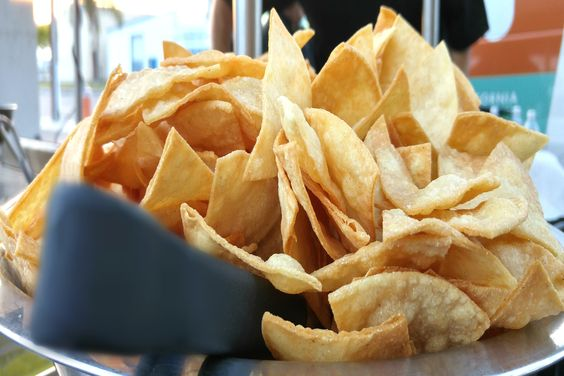 This jumbo sized bowl of piping hot, freshly-made tortilla chips is ready to have its golden twisted contents dipped and crunched here at a private luncheon near our #DTLA office.  More: https://www.sohotaco.com/2015/07/08/serving-up-a-huge-bowl-of-warm-tortilla-chips-in-los-angeles #tacocatering #lafoodies #losangeles