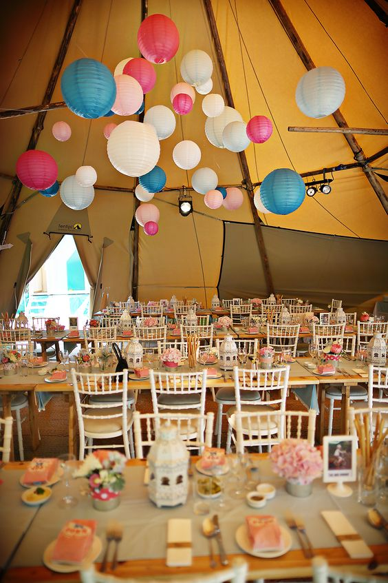 use bold lanterns to contrast the tipi marquee for a fun and unique style…