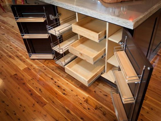 Undercounter island storage includes a supercabinet that makes use of every inch of space. Shelving and pullout drawers accommodate table linens, pantry items and glassware.