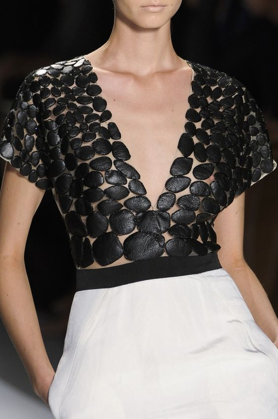 Leather pebble appliqué dress bodice design - fabric manipulation for fashion; monochrome surface pattern detail // Prabal Gurung: