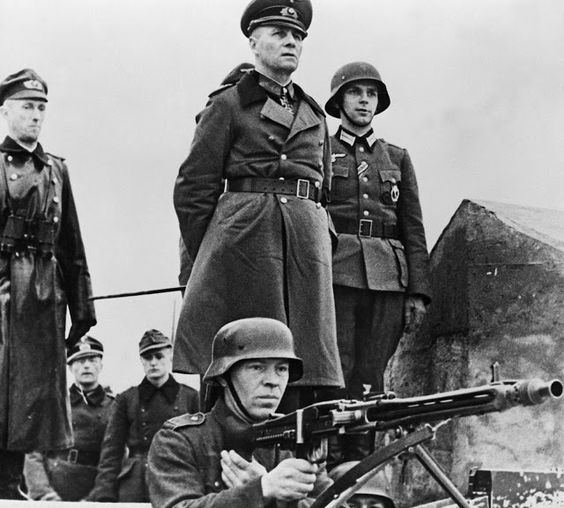 Erwin Rommel inspecting Omaha beach defenses, 1944. Rommel was a military genius and an honorable warrior who died for conspiring to assassinate Hitler.