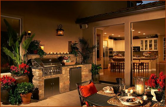 Rustic stone outdoor kitchen and patio with red accents