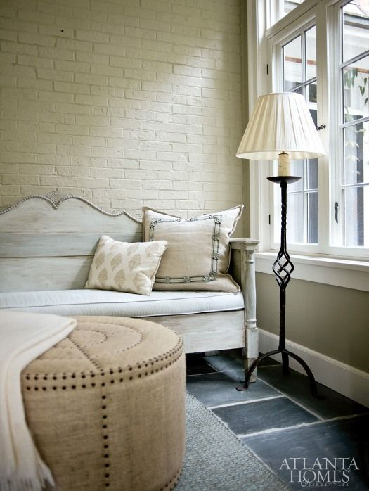 painted brick, upholstery tacks & elegant pillow trim. interior design by beth ervin via atlanta home & lifestyles, via verdigris vie