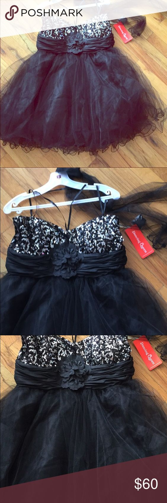 Black tulle poofy dress with silver sequinSz 2x. Brand new Dancing Queen Black short tulle poofy dress with silver sequined sweetheart neckline and detachable flower. Also comes with attachable straps and tulle shawl Sz 2x. Dancing Queen Dresses Prom