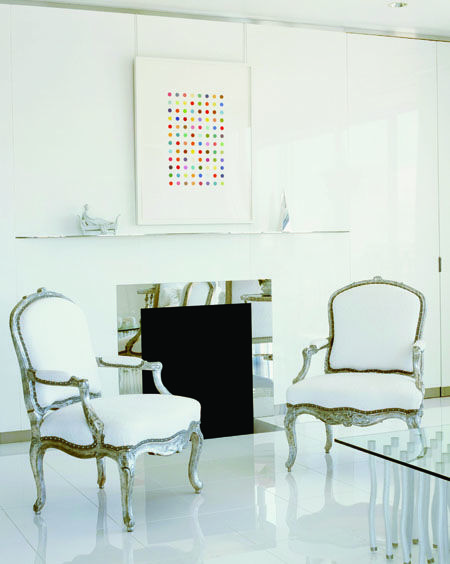 In this San Francisco apartment Orlando Diaz-Azcuy created a white lacquered shell to house his clients' disparate collection of furnishings. Thanks to white walls (and the timeless white marble floor) contemporary furniture and edgy art feel akin to Louis XV armchairs even though they were created centuries apart.