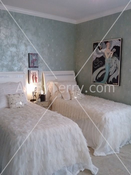 Metallic plaster finish with a silver raised stencil with lots of rhinestones Click to View Full-Screen Image