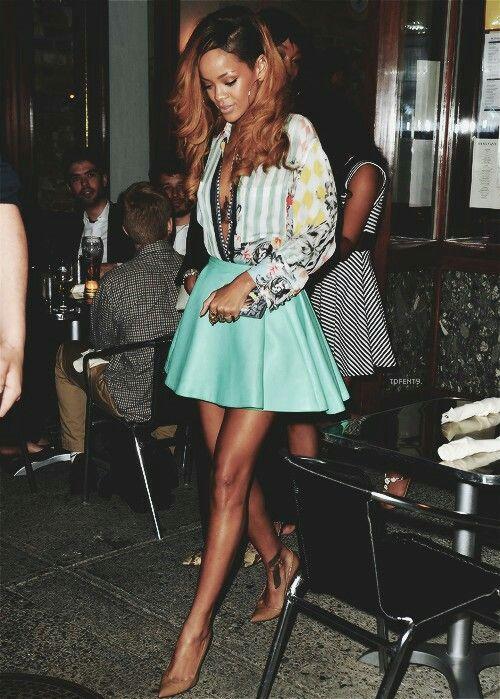 Stylish rihanna wearing a mint skirt