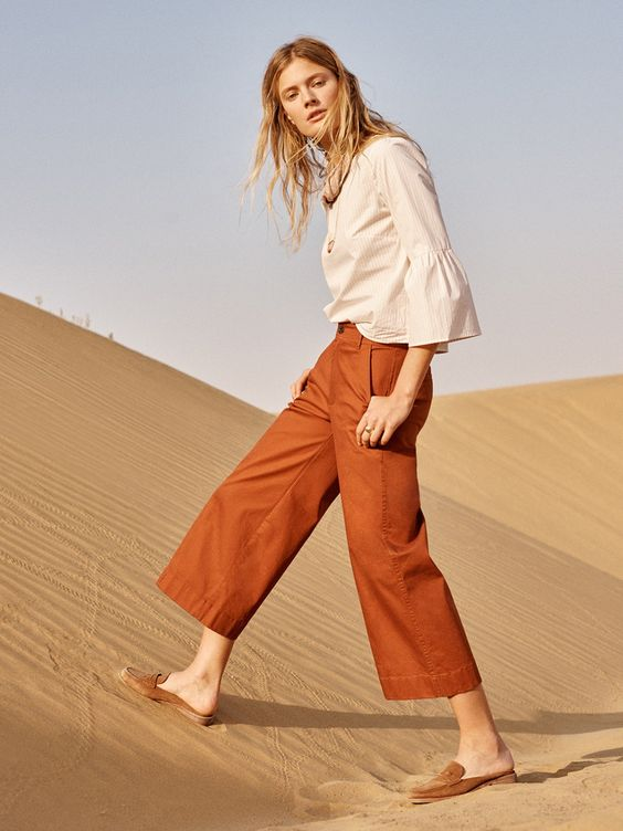 madewell langford wide-leg crop pants worn with the bell-sleeve top + elinor loafer mule.