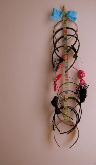Headband Organizer. Takes about 15 minutes. It's ribbon folded in half then sectioned off with sewn on buttons. Headbands slide through the gaps between the buttons.