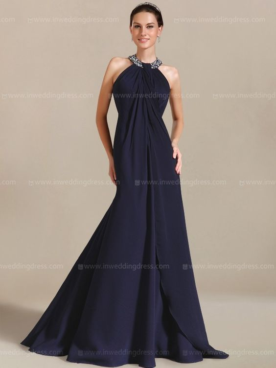 Floor length elegant prom dress will let you dazzle and shine in the spotlight. This distinctive design was made to be a fashion hit. Highlights of this dress include a halter style neckline with beading and a fully ruched bodice. This delightful dress will definitely be a great choice for your ceremony. Available in 60 colors, shown in Navy.