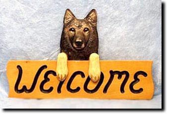 """This distinguished Belgian Tervuren dog head welcome wooden sign measures 4 x 15 inches (4"""" by 15""""). The dog lover in you will appreciate the beauty of your very own custom hand-painted piece."""
