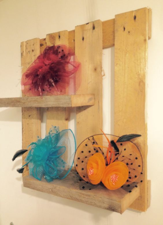 Fascinators in Breda's Gift Shop displayed on rustic shelving made from pallets.
