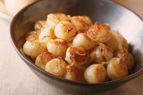 Sweet tender bay scallops sauteed with garlic and served with parsley and lemon. Serve this garlic and scallops recipe with rice or pasta.