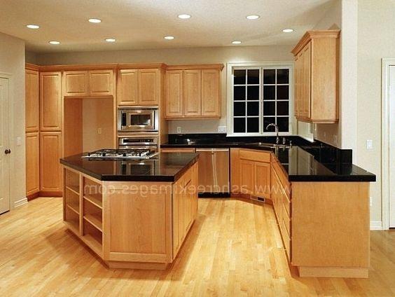 Dark granite countertops on maple cabinets black granite for Dark cabinets light granite