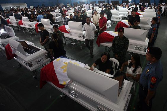 Relatives of the 44 slain PNP-SAF commandos killed in the January 25 Mamasapano clash attend the wake and necrological service at Camp Bagong Diwa in Taguig on Friday, January 30. President Benigno Aquino III offered his condolences to those left behind by the heroes.