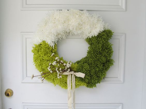 Make Your Own Color-Blocked Pom-Pom Wreath >> http://blog.diynetwork.com/maderemade/how-to/how-to-make-an-ombre-pom-pom-wreath?soc=pinterest
