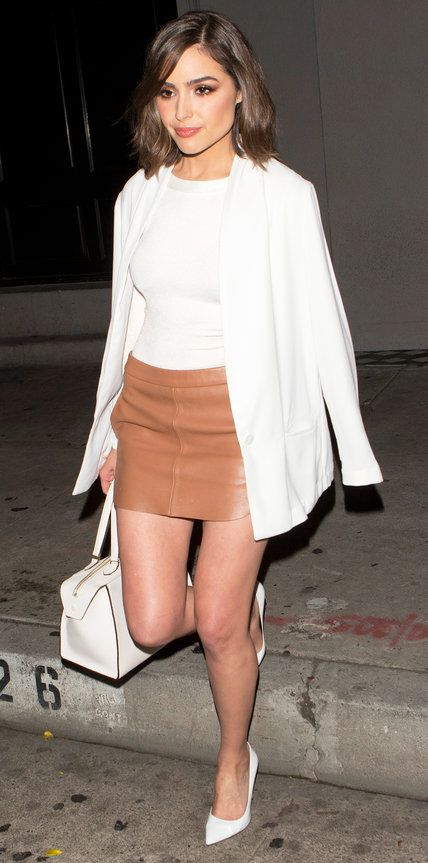 For a dinner out in West Hollywood, Olivia Culpo gave her tan leather mini a fresh spin by styling it with a crisp white blazer draped over a white top. The finishing touch? An equally white tote-all and pumps.: