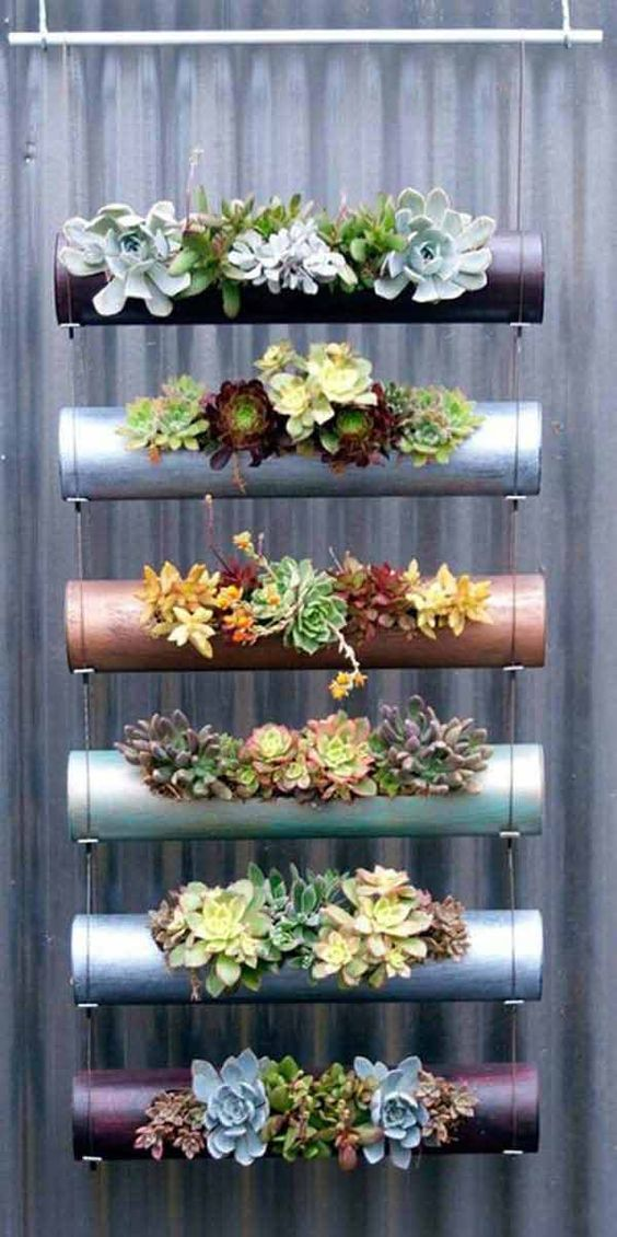 PVC pipes planter with succulents: 28 Adorable DIY Hanging Planter Ideas To Beautify Your Home