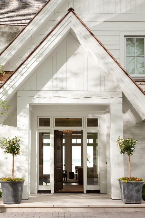 Beautiful Entry! White Exterior with Cedar Shake Roof:
