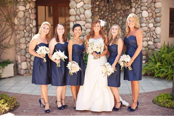 Love the navy ribbon on the brides flowers to match the dresses...may do this with bouquets of more green and white flowers