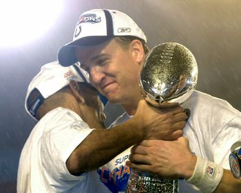 Coach Tony Dungy and Peyton Manning hug after winning Superbowl XLI.