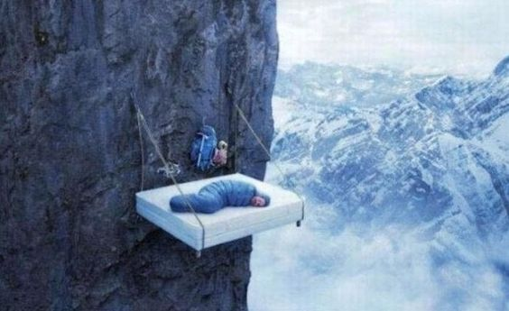 Bed hanging off the side of a mountain!