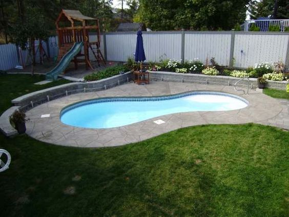 The family area with the pool and lawn is separated from for Pool area ideas