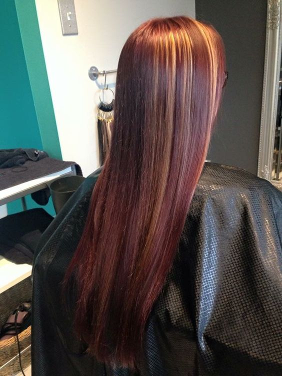My red hair with peekaboo caramel highlights!! Done by Rachael at Rock Paper Scissors