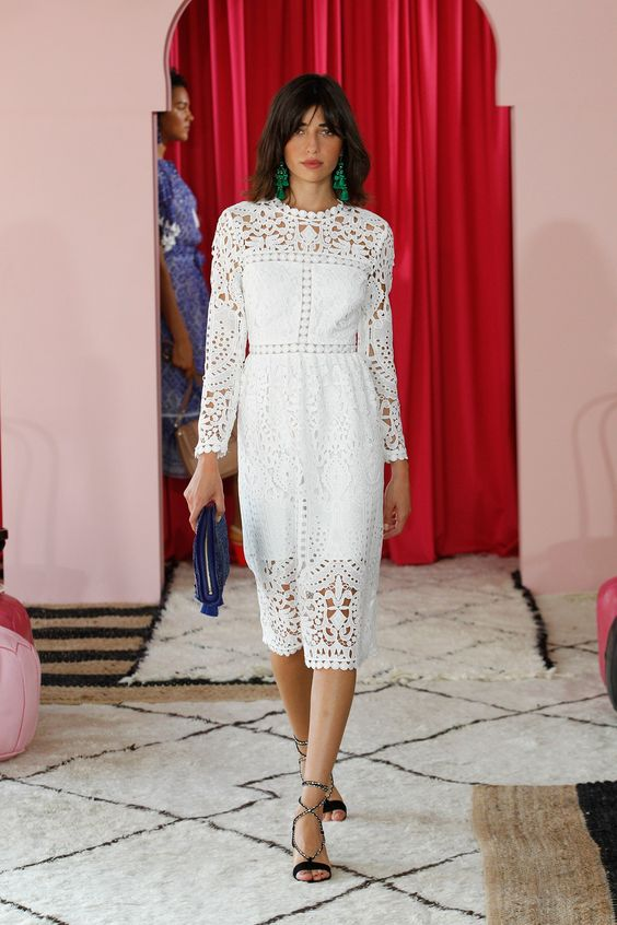 Kate Spade New York Spring 2017 Ready-to-Wear: Another gorgeous white embroidered lace dress but this time the dress has long sleeves. I like the pop of color with the green earrings.