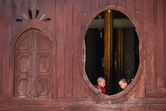 Novice monks play a game at Shwe Yan Pyay Monastery on Inle Lake.   The site is a great spot to take pictures of monks as they pose in the huge teak windows.